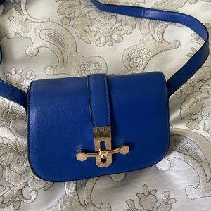 Striking blue cross body bag with gold trim